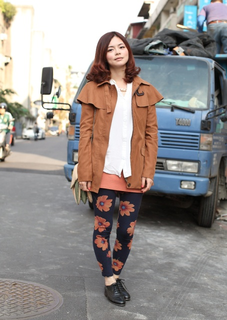 With white shirt, lace up shoes and suede jacket