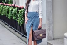 With white shirt, leather bag and beige pumps