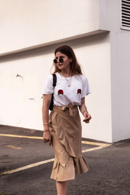 With white shirt, mini bag and sunglasses