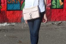 With white shirt, scarf, skinny jeans and pale pink bag