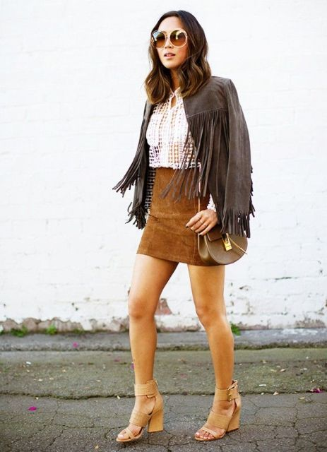 With white shirt, suede mini skirt, sandals and brown bag