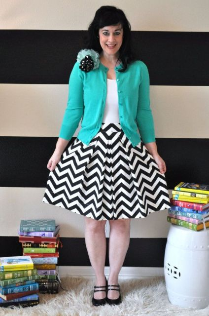 With white shirt, turquoise cardigan and black flats