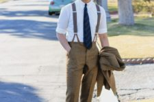 With white shirt, tweed pants, brown shoes and tie