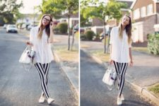 With white shirt, white sneakers and bag