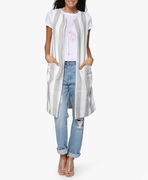 With white t shirt, boyfriend jeans and lucite shoes