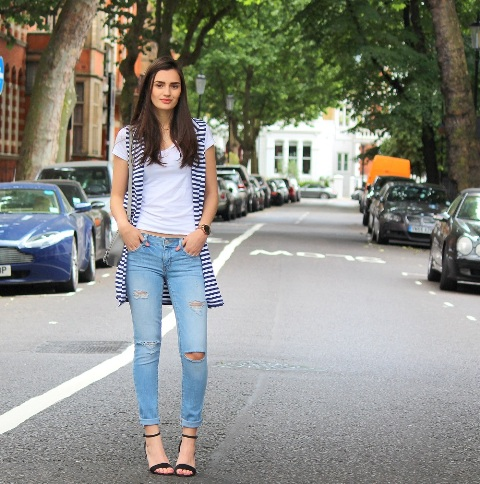 With white t shirt, distressed jeans and black sandals