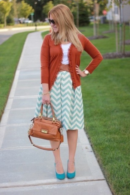 With white t-shirt, orange cardigan, turquoise shoes and brown bag