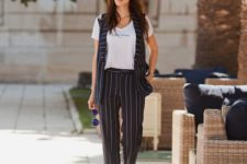 With white t-shirt, striped wide-leg trousers and white flat shoes