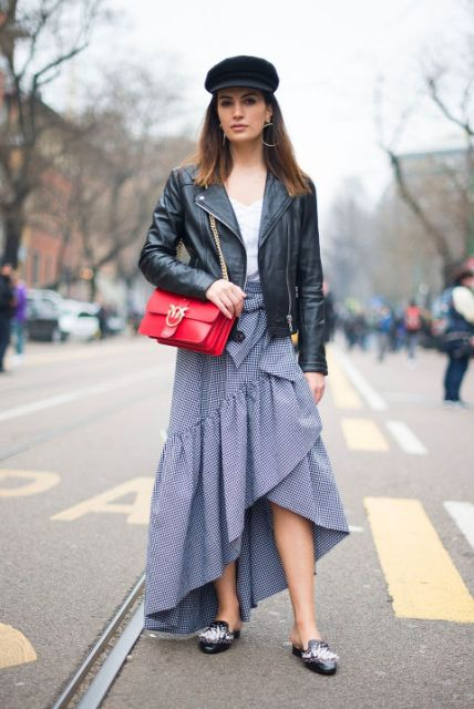 With white top, black leather jacket, black cap, red chain strap bag and flat mules