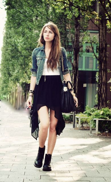 With white top, denim jacket, lace up boots and chain strap bag