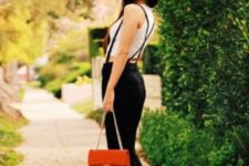 With white top, heels and red bag