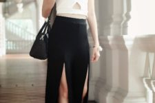 With white top, lace up shoes and black bag