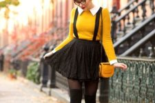 With yellow shirt, yellow leather small bag and black tigths and shoes