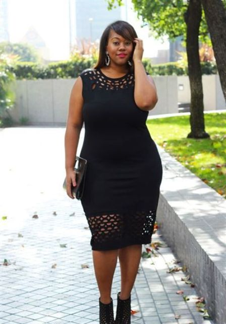 a black cutout midi dress with sheer detailing and matching black shoes for a wow effect