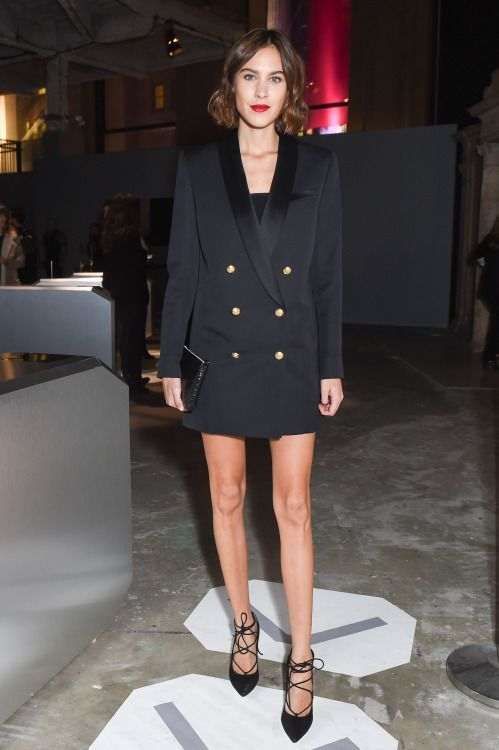 a black double-breast tuxedo dress and black lacing up shoes with a clutch