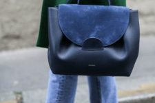 02 a black leather and blue suede handbag is a trendy piece to go anywhere