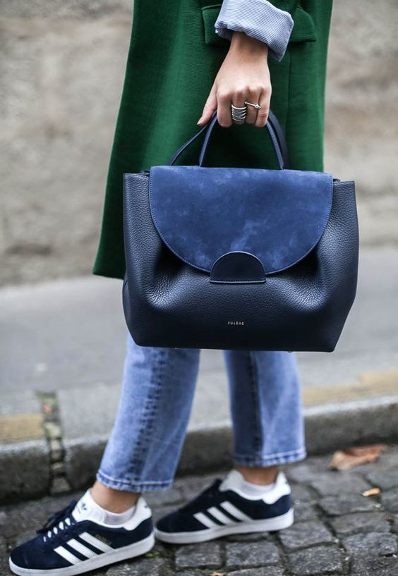 a black leather and blue suede handbag is a trendy piece to go anywhere