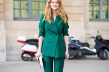 02 a bold emerald pantsuit with a double-sided jacket, cropped pants, metallic shoes and a clutch