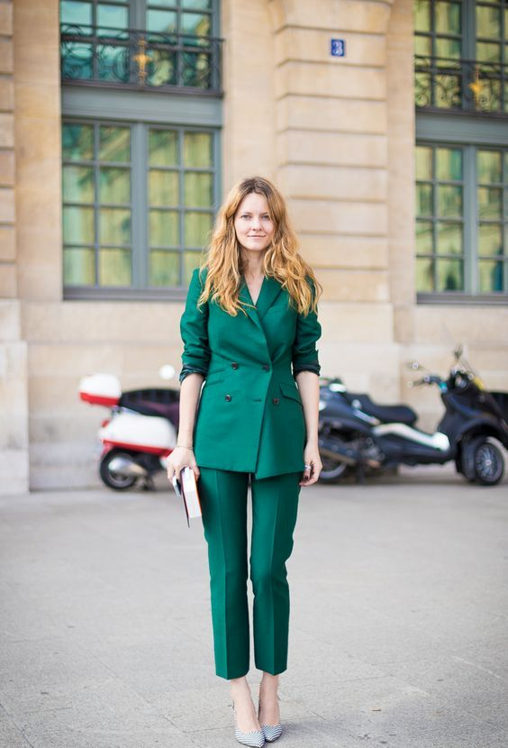 a bold emerald pantsuit with a double sided jacket, cropped pants, metallic shoes and a clutch