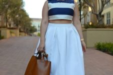 02 a full A-line white skirt, a navy and white striped top, brown shoes and a brown bag