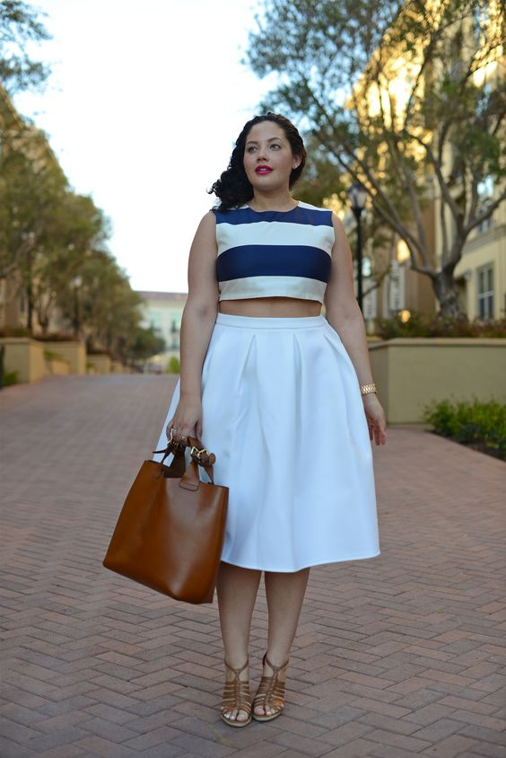 a full A-line white skirt, a navy and white striped top, brown shoes and a brown bag