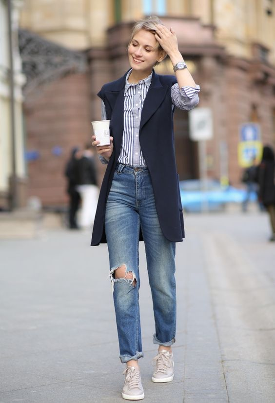 boyfriends, grey sneakers, a striped shirt and a navy long vest for a relaxed casual look
