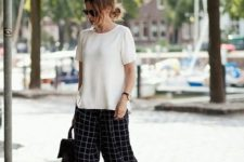 02 checked black and white culottes, a white top, black heels and a backpack to work