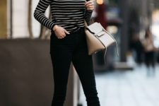 02 nude pumps and a neutral bag, black raw edge jeans and a black and white striped top