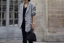 03 a black top, black cropped pants, an oversized checked blazer and a black bag
