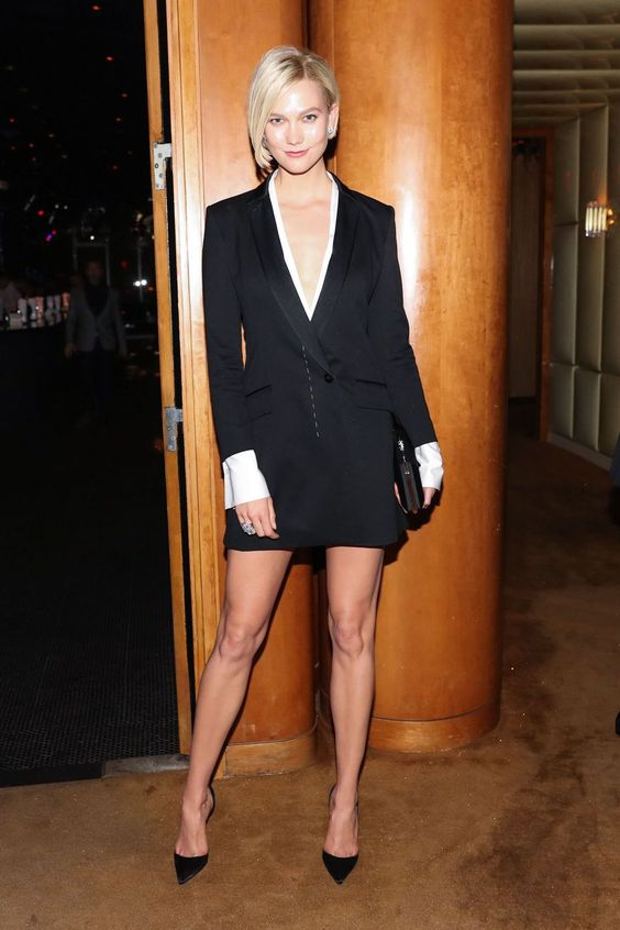 a black tuxedo dress with a blouse, black heels and a clutch for a sexy look