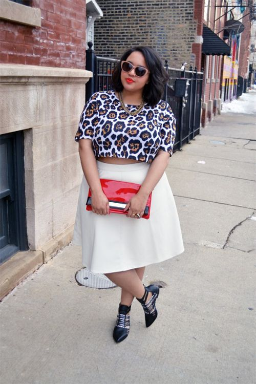 a creamy full skirt, a leopard print crop top, a statement necklace, black boots and a red clutch