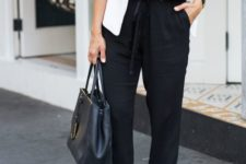 03 a relaxed black jumpsuit, a white jacket, blush shoes and a black bag