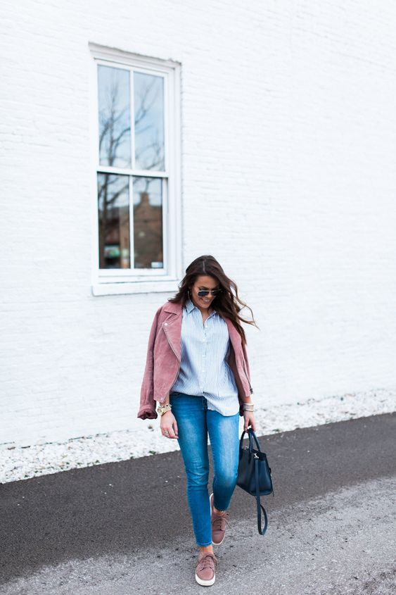 a striped shirt, blue skinnies, a pink suede jacket and pink sneakers plus a navy bag