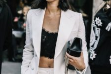 03 a white pantsuit worn with a black lace crop top is a chic idea for a special occasion