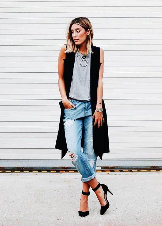 ripped boyfriend jeans, a grey tee, blakc heels and a long vest plus a statement necklace