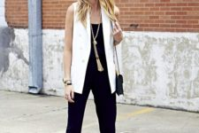 04 a black jumpsuit, a long white vest, red strappy heels and a statement rope necklace for a chic look