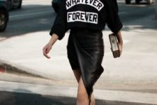 04 a black printed sweatshirt, a black leather asymmetrical skirt, black shoes and a statement chain necklace