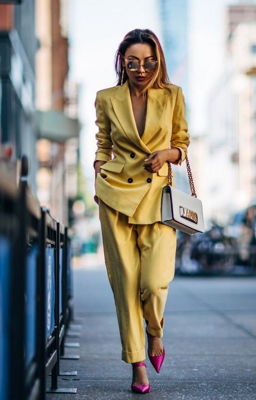 a bold yellow pantsuit with no top under and bold pink shoes for a special occasion