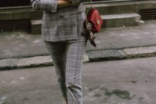 04 a plaid grey suit with cropped pants, a white tee, heart printed sneakers and a red bag