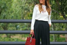 04 black culottes, black heels, a white sihrt with lace inserts and a red bag