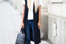 04 blue skinnies, a white tee, black long vest and black flats for a business casual look