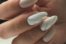 04 nude nailts plus two accent white marble ones for a trendy look