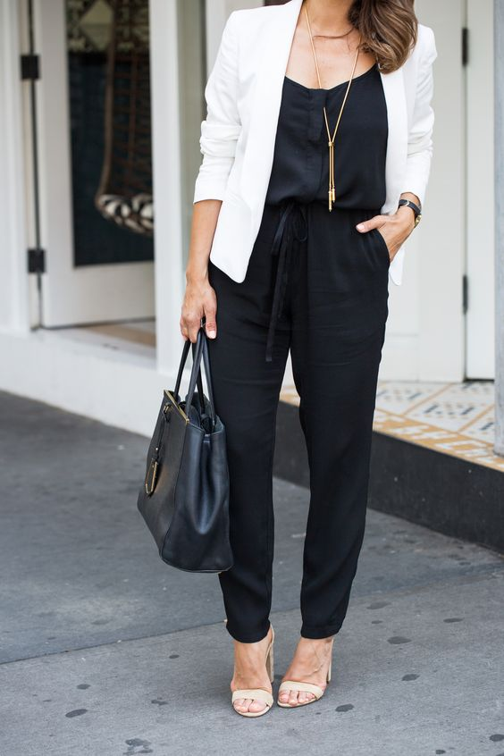 a black jumpsuit, a white blazer, blush shoes and a large black bag for a chic look