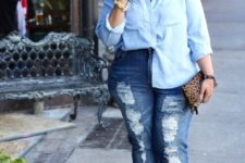 a chambray shirt, blue ripped jeans, bold red mules and a leopard print clutch