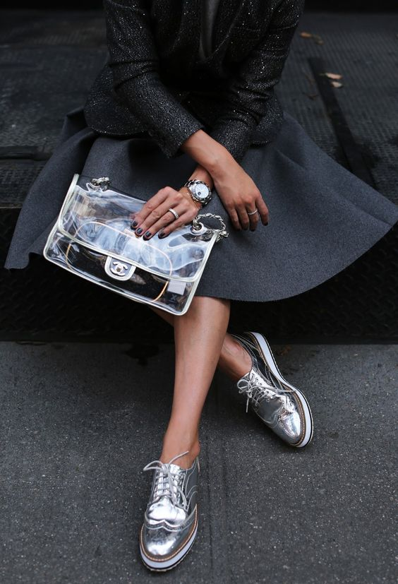 a trendy clear bag by Chanel is a bold idea to accentuate your outfit