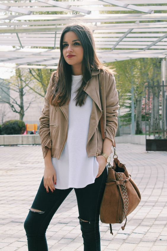 a white tee, a tan suede jacket, black ripped jeans and a brown bag