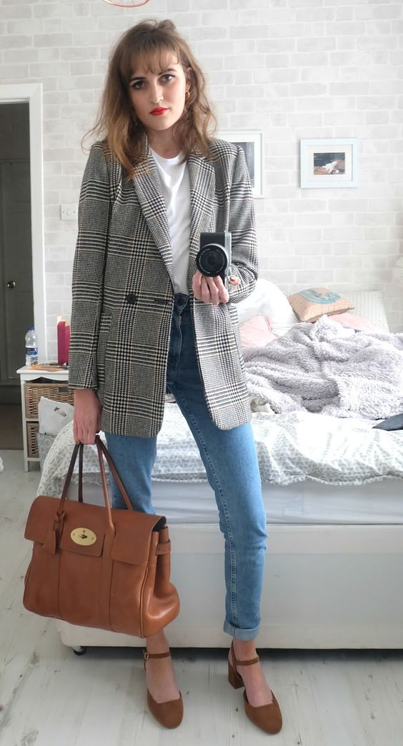 a white tee, blue cuffed jeans, a grey checked blazer, rust suede shoes and a matching bag