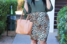 05 an army green top with long sleeves, a leopard print knee skirt, black shoes and a tan bag