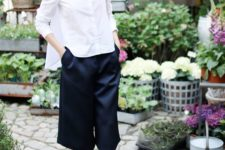 05 black culottes, a white shirt, black heels and a bag is a fresh take on the traditional monochrome comobo