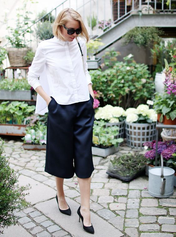 black culottes, a white shirt, black heels and a bag is a fresh take on the traditional monochrome comobo